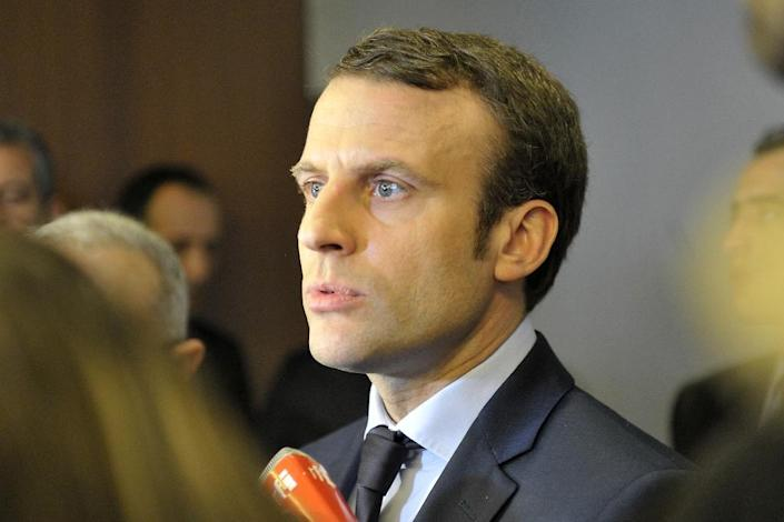 French presidential hopeful Emmanuel Macron's aides have accused the state-owned Russia Today (RT) channel and the Sputnik news agency of waging a smear campaign against the 39-year-old former economy minister (AFP Photo/STRINGER)