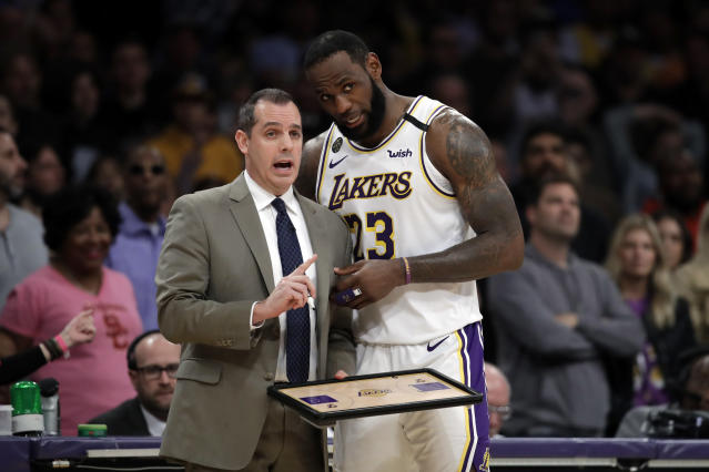 Los Angeles Lakers head coach Frank Vogel, left, talks to LeBron James during the second half of an NBA basketball game against the Boston Celtics Sunday, Feb. 23, 2020, in Los Angeles. (AP Photo/Marcio Jose Sanchez)