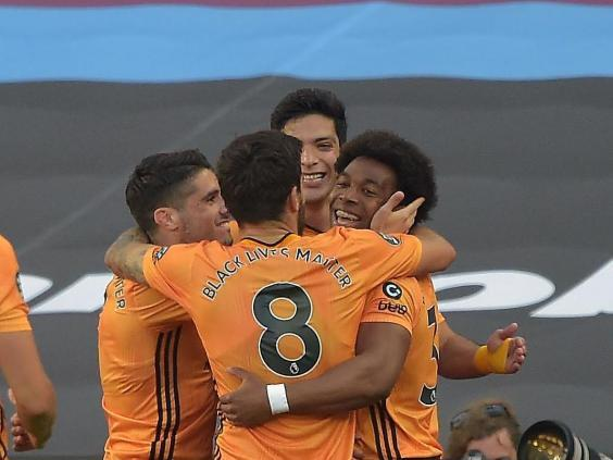 Traore celebrates with his Wolves teammates (Getty)
