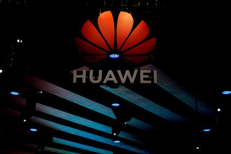 FILE PHOTO: A Huawei logo is pictured during the media day for the Shanghai auto show in Shanghai, China April 16, 2019. REUTERS/Aly Song/File Photo