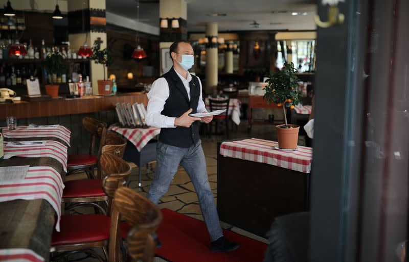 Waiter Ivan works at the Francucci's Ristorante, amid the COVID-19 outbreak in Berlin