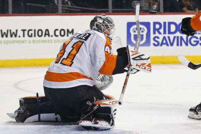 Philadelphia Flyers goaltender Anthony Stolarz deflects the puck with his stick on a shot by the New York Islanders in the second period of a preseason NHL hockey game on Tuesday, Sept. 18, 2018, in New York. (AP Photo/Adam Hunger)