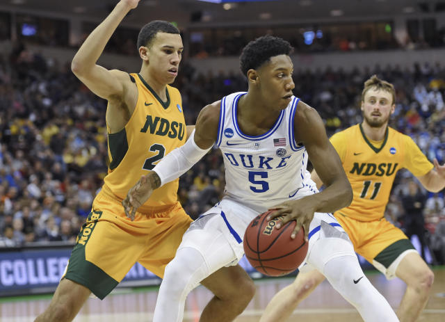 Duke's RJ Barrett dribbles while defended by North Dakota State's Jaxon Knotek (2) and Jared Samuelson (11) during a first-round game in the NCAA men's college basketball tournament in Columbia, S.C. Friday, March 22, 2019. (AP Photo/Richard Shiro)