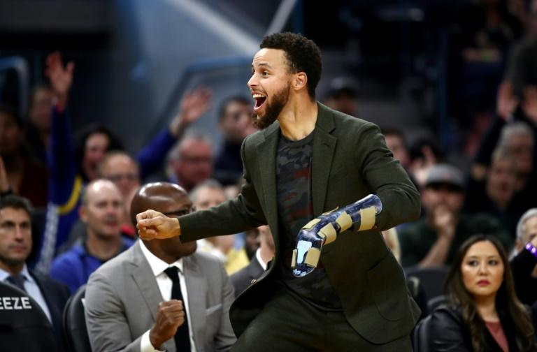 Golden State star Stephen Curry, here cheering on the Warriors from the bench, has taken part in full-contact practice for the first time since breaking his left hand in October