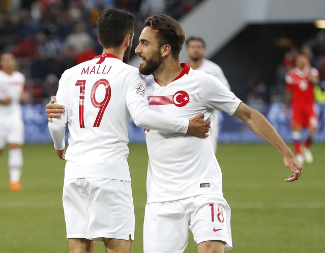 Turkey's Yunus Malli, left, celebrates with team mate Kenan Karaman after scoring his side's opening goal during a friendly soccer match between Russia and Turkey at the VEB Arena stadium in Moscow, Russia, Tuesday, June 5, 2018. (AP Photo/Pavel Golovkin)