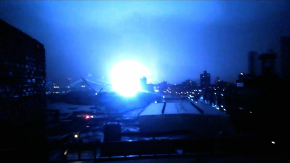 This image from video provided by Dani Hart shows what appears to be a transformer exploding in lower Manhattan as seen from a building rooftop from the Navy Yard in Brooklyn during Sandy's arrival in New York City. Much of New York was plunged into darkness Monday by a superstorm that overflowed the city's historic waterfront, flooded the financial district and subway tunnels and cut power to nearly a million people. (AP Photo/Dani Hart)