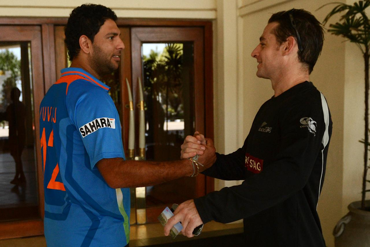 Indian cricketer Yuvraj Singh (L) and New Zealand cricketer Brendon McCullum (R) greet each other in a hotel lobby ahead of the World Cup Twenty20 cricket tournament in Colombo on September 14, 2012. The two-yearly tournament in cricket's shortest format will be played from September 18 to October 7, with Hambantota holding three matches, Pallekele nine and capital Colombo fifteen. AFP PHOTO/Ishara S.KODIKARA