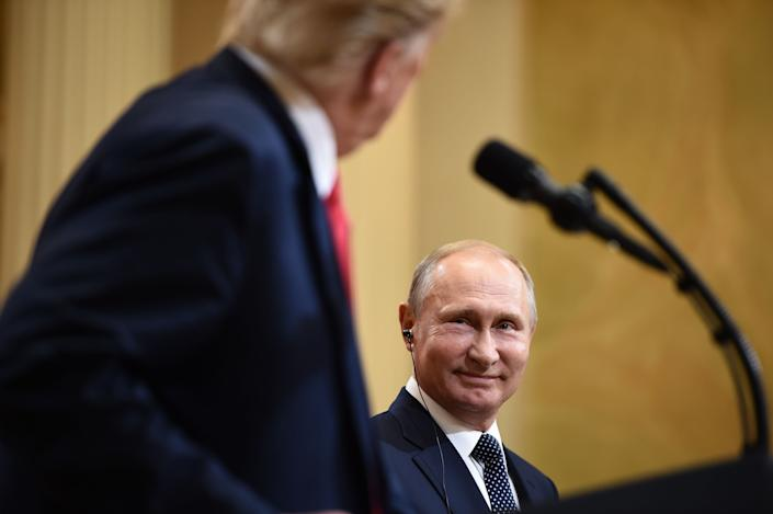 U.S. President Donald Trump and Russia's President Vladimir Putin at what became an <a href=&quot;https://www.npr.org/2018/07/17/629601233/trumps-helsinki-bow-to-putin-leaves-world-wondering-whats-up&quot; target=&quot;_blank&quot; rel=&quot;noopener noreferrer&quot;>infamous joint press conference</a> in Helsinki on July 16, 2018. Ignoring findings from his own intelligence officials, Trump accepted Putin's denial of Russian interference in the 2016 U.S. election. (Photo: BRENDAN SMIALOWSKI via Getty Images)