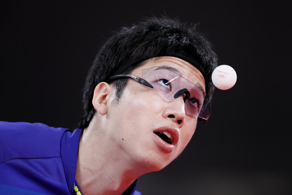 <p>Jun Mizutani of Team Japan serves during his Men's Team Round of 16 table tennis match on day ten of the Tokyo 2020 Olympic Games at Tokyo Metropolitan Gymnasium on August 02, 2021 in Tokyo, Japan. (Photo by Steph Chambers/Getty Images)</p>