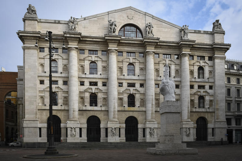MILAN, ITALY - March 29, 2020: General view shows almost deserted piazza Affari ('Business Square'). In the background there is Palazzo Mezzanotte, the headquarter of Borsa Italiana, while in the foreground stands the statue L.O.V.E., also known as Il Dito ('The Finger'), by Italian contemporary artist Maurizio Cattelan. The Italian government imposed unprecedented restrictions to halt the spread of COVID-19 coronavirus outbreak, among other measures people movements are allowed only for work, for buying essential goods and for health reasons. (Photo by Nicol� Campo/Sipa USA)