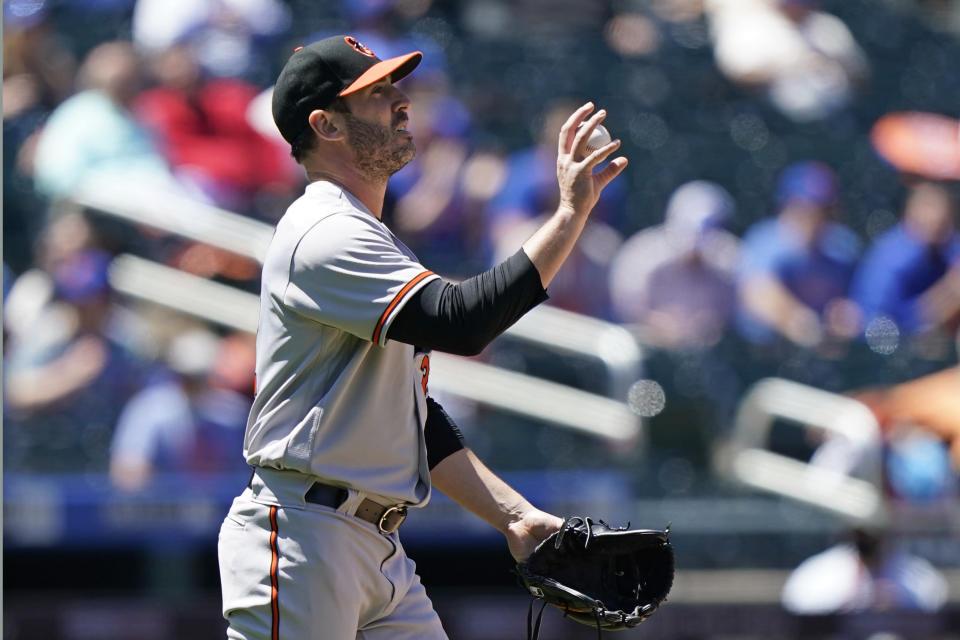 Baltimore Orioles starting pitcher Matt Harvey (32) reacts shortly before being taken out of the game during the fifth inning of a baseball game against the New York Mets, Wednesday, May 12, 2021, in New York. (AP Photo/Kathy Willens)