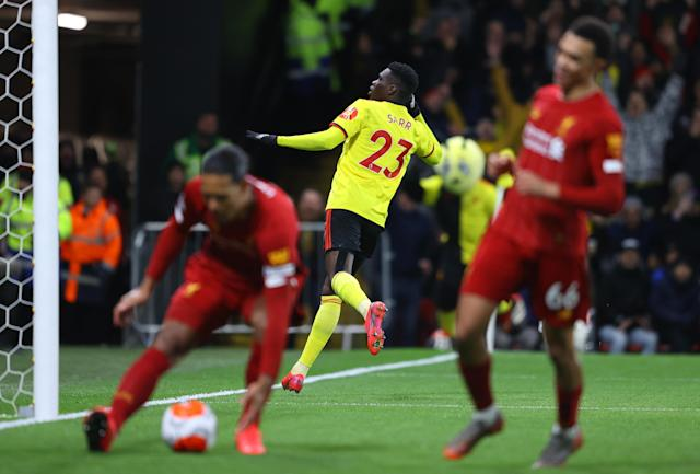 Ismaïla Sarr celebrates after scoring the second goal of Watford's shock win over Liverpool. (Photo by Richard Heathcote/Getty Images)