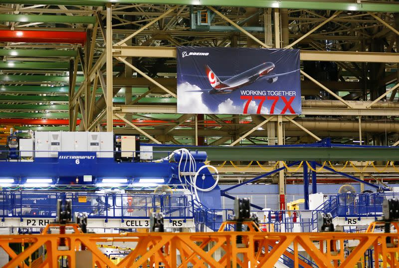 FILE PHOTO: A large 777X banner is seen hanging over the Boeing 777X Final Assembly Building floor during a media tour of Boeing production facilities in Everett