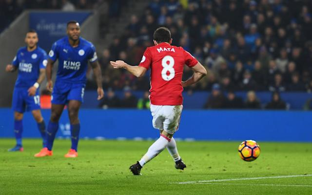 <p>Juan Mata of Manchester United scores their third goal goal during the Premier League match between Leicester City and Manchester United at The King Power Stadium on February 5, 2017 in Leicester, England. </p>