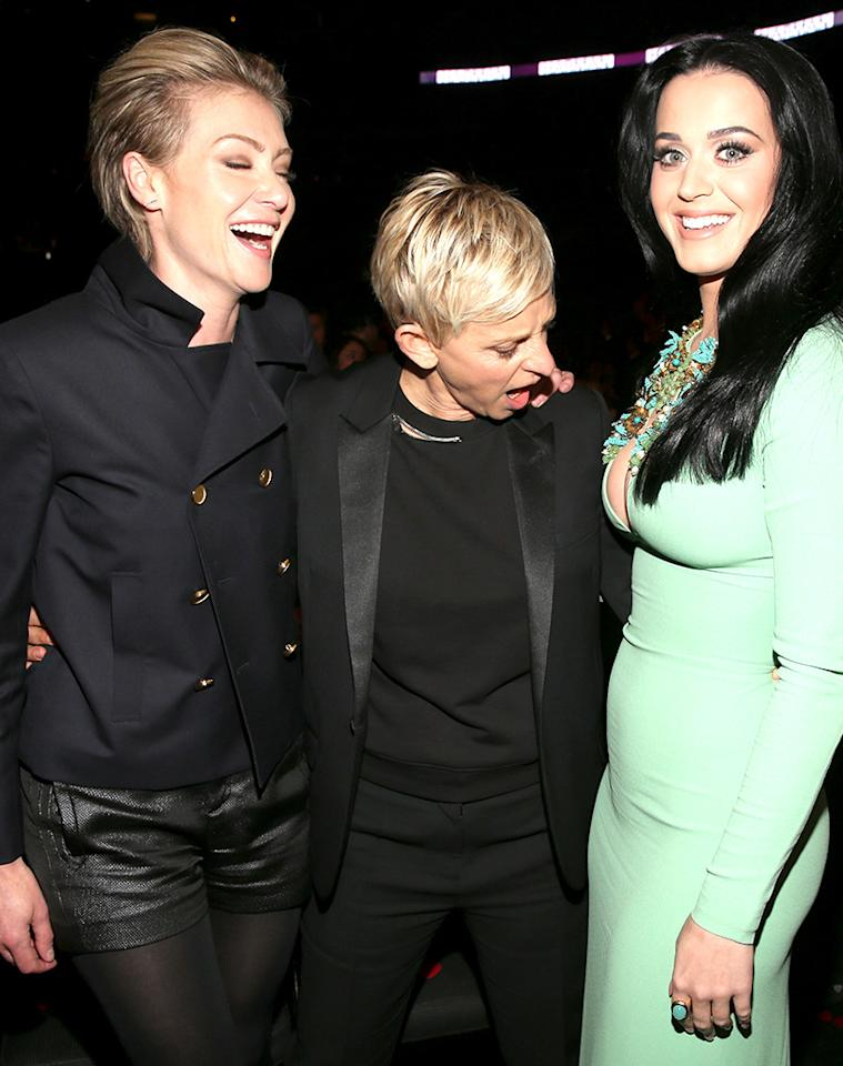 In this photo, Ellen DeGeneres and Portia de Rossi get the last laugh. Who knows what the subject of the joke was, but the body language seems to suggest that Katy Perry's impressive figure might be involved.