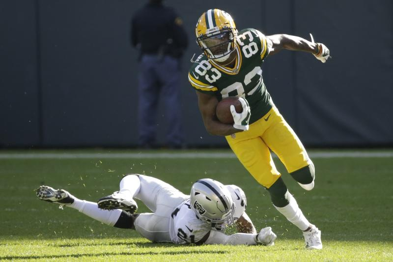 Green Bay Packers' Marquez Valdes-Scantling breaks away from Oakland Raiders' Gareon Conley for a touchdown catch during the second half of an NFL football game Sunday, Oct. 20, 2019, in Green Bay, Wis. (AP Photo/Mike Roemer)