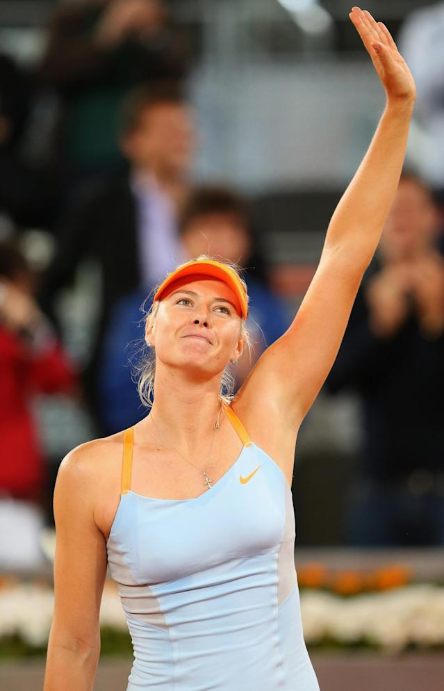 MADRID, SPAIN - MAY 07: Maria Sharapova of Russia thanks the support after defeating Christina McHale of USA during day four of the Mutua Madrid Open tennis tournament at the Caja Magica on May 7, 2013 in Madrid, Spain. (Photo by Julian Finney/Getty Images)