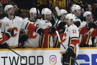 Calgary Flames center Mikael Backlund (11), of Sweden, is congratulated after scoring against the Nashville Predators during the second period of an NHL hockey game Thursday, Feb. 27, 2020, in Nashville, Tenn. (AP Photo/Mark Zaleski)