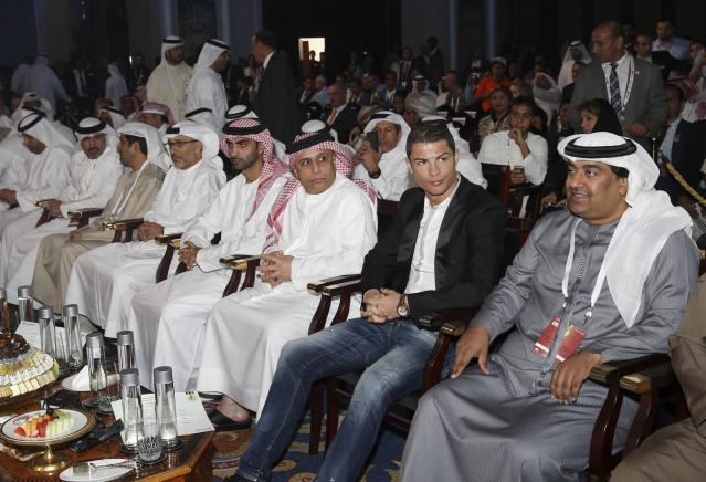 Cristiano Ronaldo (2nd R), who plays for Real Madrid and Portugal's national soccer team, attends the eighth Dubai International Sports Conference, in Dubai December 28, 2013. REUTERS/Mohammed Omar (UNITED ARAB EMIRATES - Tags: SPORT SOCCER)