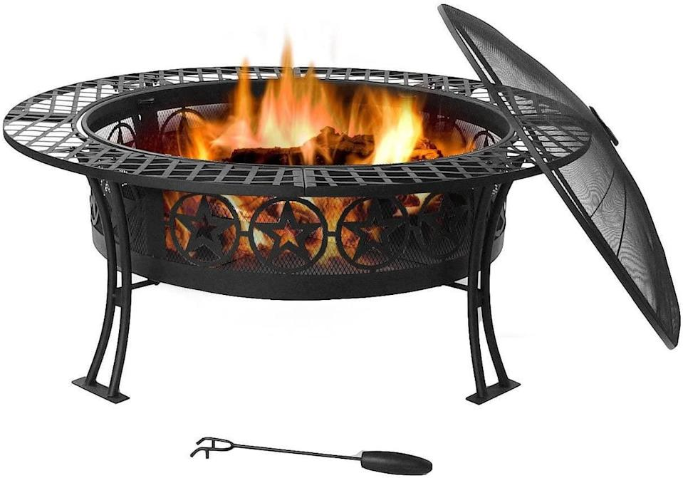 <p>Easily open the lid on the <span>Sunnydaze Four Star Fire Pit</span> ($185) to allow access for quick grilling.</p>