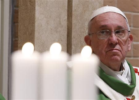 Pope Francis celebrates a mass during his pastoral visit to the Saint Tommaso parish on the outskirts of Rome