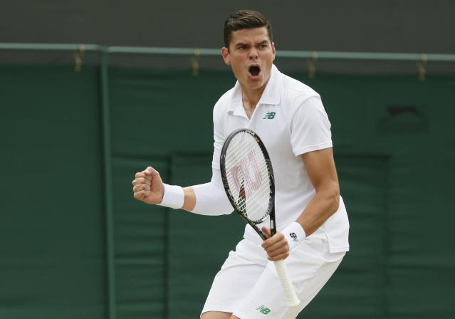 Milos Raonic of Canada reacts as he breaks the service of Jack Sock of the U.S. during their men's singles tennis match at the Wimbledon Tennis Championships, in London June 26, 2014. REUTERS/Stefan Wermuth (BRITAIN - Tags: SPORT TENNIS)