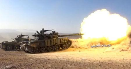 A still image taken on August 19, 2017 from a footage of Hezbollah military handout shows a Hezbollah military tank firing at western Qalamoun, Syria. Hezbollah Military Handout via Reuters TV.