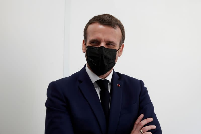 FILE PHOTO: French President Macron visits a coronavirus disease (COVID-19) vaccination center in Bobigny