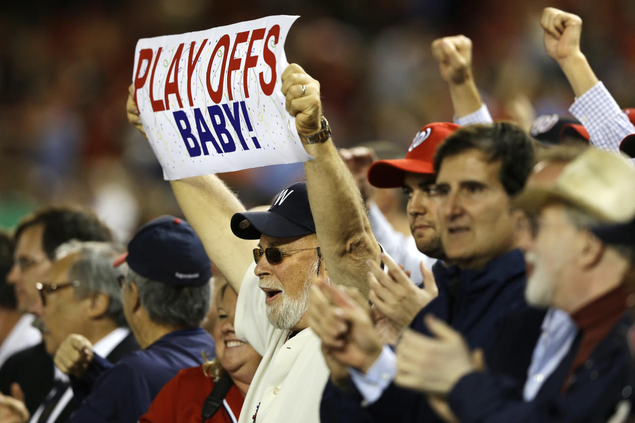 Fans celebrate the Washington Nationals as they clinched a playoff spot Thursday night with a 4-1 win over the Los Angeles Dodgers in a baseball game at Nationals Park, in Washington, on Thursday, Sept. 20, 2012. (AP Photo/Jacquelyn Martin)
