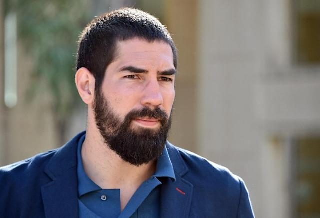 French handball player Nikola Karabatic arrives at Montpellier's courthouse, southern France, on June 25, 2015 (AFP Photo/Pascal Guyot)