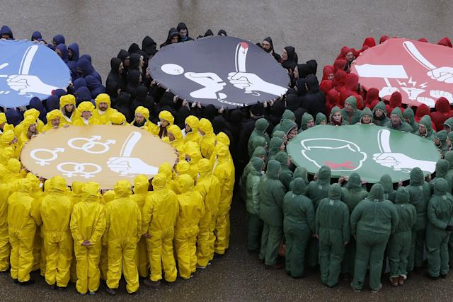 Activists of various NGOs gather in Paris to form the Olympics rings to protest against human rights violations in Russia ahead of the Sochi Winter Olympics.
