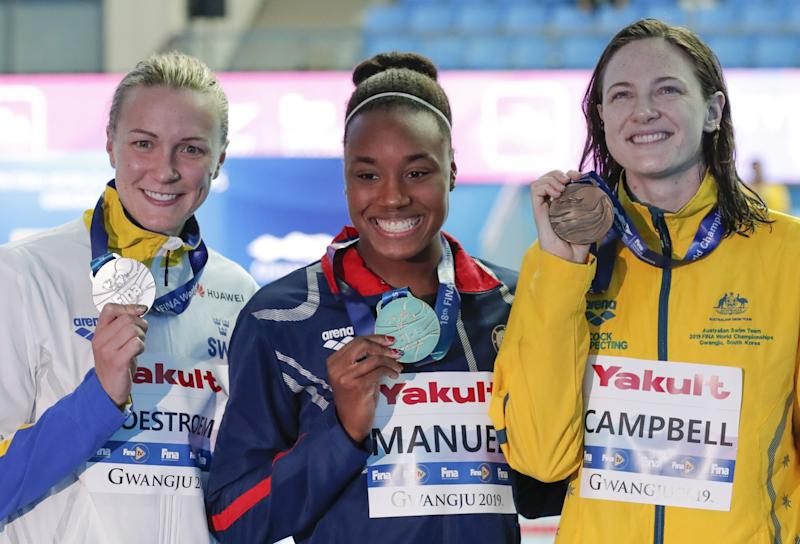 2018 world championships 50-meter gold medalist Simone Manuel with Sarah Sjostrom (silver), left, and Cate Campbell (bronze).