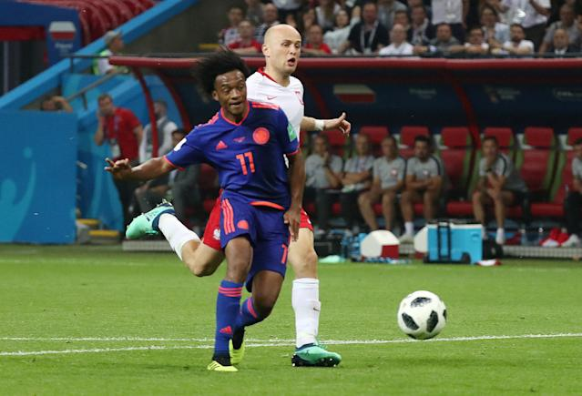 Soccer Football - World Cup - Group H - Poland vs Colombia - Kazan Arena, Kazan, Russia - June 24, 2018 Colombia's Juan Cuadrado scores their third goal REUTERS/Sergio Perez TPX IMAGES OF THE DAY