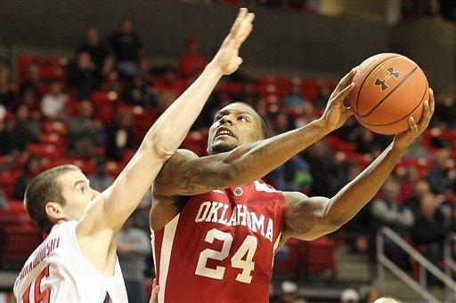 Oklahoma's Romero Osby shoots against Texas Tech's Robert Lewandowski during their NCAA college basketball game in Lubbock, Texas, Saturday, Feb. 11, 2012. (AP Photo/Lubbock Avalanche-Journal, Zach Long) ALL LOCAL TV OUT
