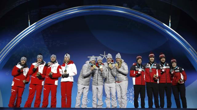 Medals Ceremony - Luge - Pyeongchang 2018 Winter Olympic Games - Team Relay - Medals Plaza - Pyeongchang, South Korea - February 16, 2018 - Gold medalists Natalie Geisenberger, Johannes Ludwig, Tobias Wendl and Tobias Arlt of Germany, silver medalists Alex Gough, Sam Edney, Tristan Walker and Justin Snith of Canada, bronze medalists Madeleine Egle, David Gleirscher, Peter Penz and Georg Fischler of Austria on the podium. REUTERS/Kim Hong-Ji