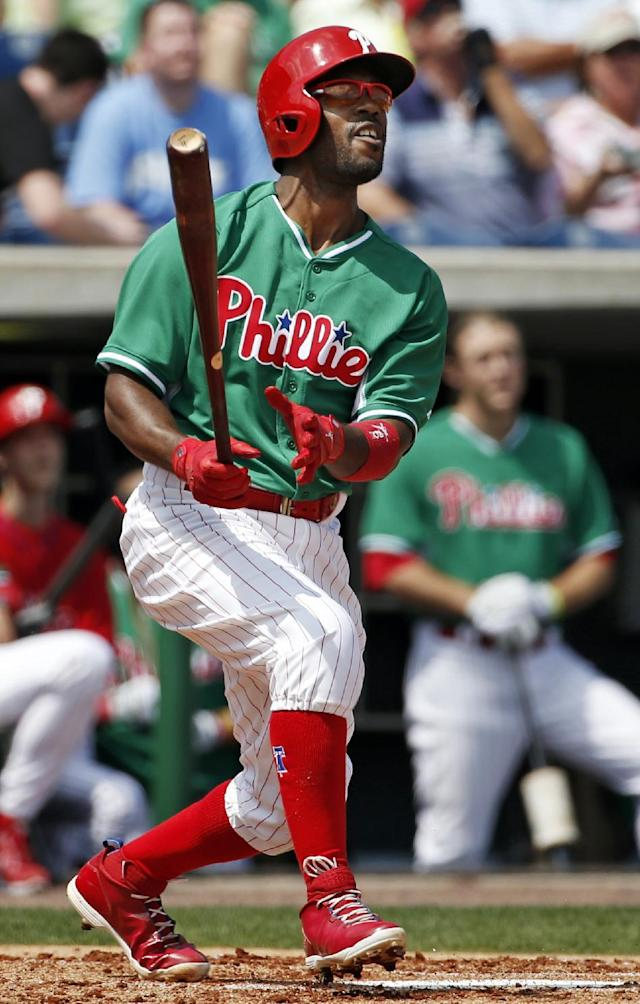 Philadelphia Phillies Jimmy Rollins watches his first-inning flyout to Toronto Blue Jays right fielder Jose Bautista in a spring exhibition baseball game in Clearwater, Fla., Thursday, March 20, 2014. (AP Photo/Kathy Willens)