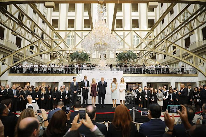 Staff at Trump's International Hotel in Washington, DC, pictured being opened by Trump in 2016, have spilled the bizarre secrets behind serving him (Getty Images)