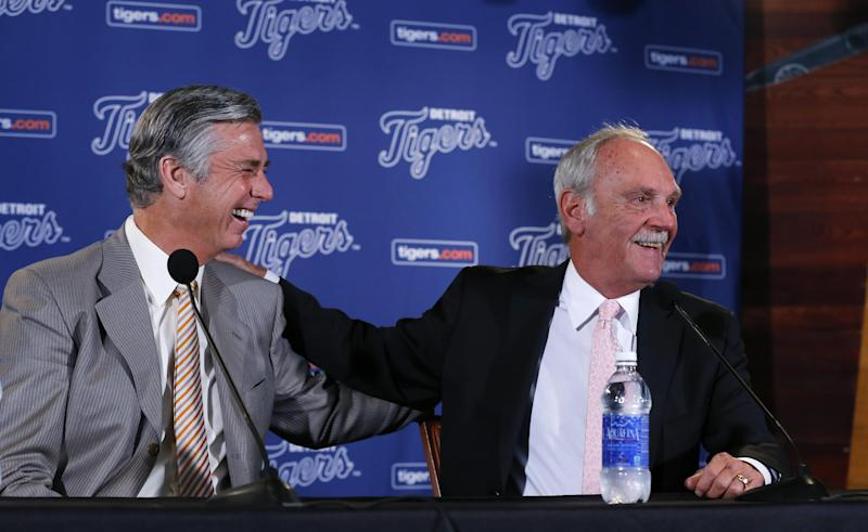 Detroit Tigers baseball manager Jim Leyland, right, laughs with general manager David Dombrowski, left, while announcing his retirement during a news conference at Comerica Park in Detroit, Monday, Oct. 21, 2013. (AP Photo/Paul Sancya)