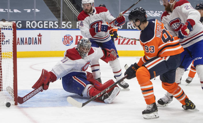 Edmonton Oilers' Ryan Nugent-Hopkins (93) is stopped by Montreal Canadiens goalie Carey Price (31) during second-period NHL hockey game action in Edmonton, Alberta, Saturday, Jan. 16, 2021. (Jason Franson/The Canadian Press via AP)
