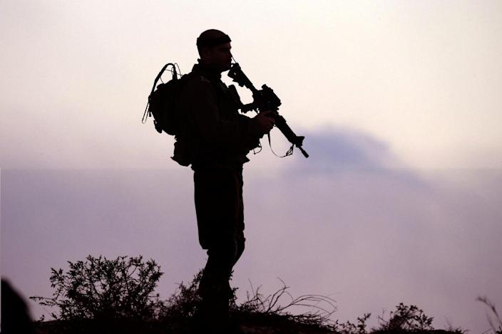An Israeli soldier keeps his position near the border with the Gaza Strip, on July 29, 2014 (AFP Photo/Jack Guez)