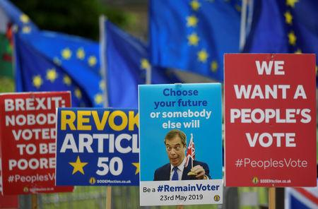 Anti-Brexit placards and EU flags are seen outside of the Houses of Parliament, ahead of the forthcoming EU elections, in London, Britain, May 22, 2019. REUTERS/Toby Melville