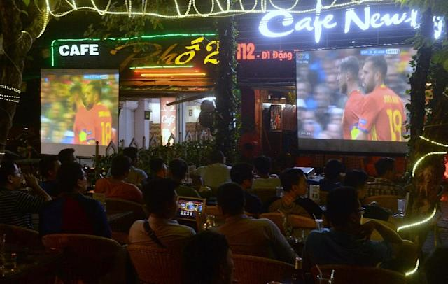 Customers watch European soccer at a Hanoi bar: sports betting is big business in Vietnam (AFP Photo/HOANG DINH NAM)