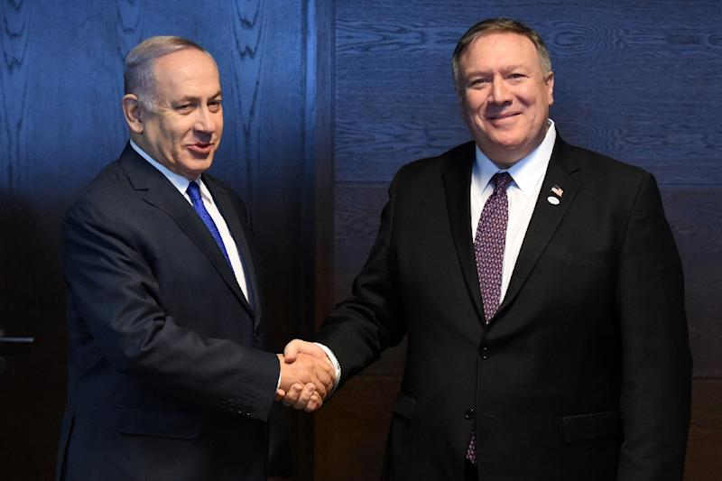 Israeli Prime Minister Benjamin Netanyahu (L) shakes hands with US Secretary of State Mike Pompeo on the sidelines of an international conference co-hosted by Washington in Warsaw and dominated by their shared hostility to Iran