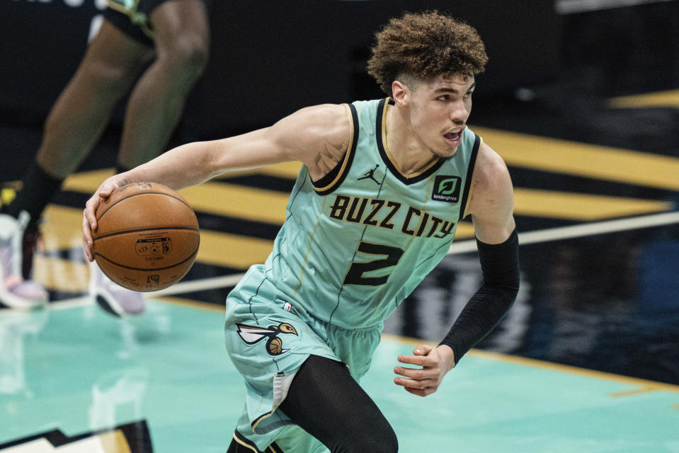 FILE - In this May 13, 2021, file photo, Charlotte Hornets guard LaMelo Ball brings the ball up against the Los Angeles Clippers during an NBA basketball game in Charlotte, N.C. LaMelo Ball made the transition from playing basketball overseas to the NBA last season look fairly easy, breezing his way to Rookie of the Year honors. Now Hornets coach James Borrego wants his point guard to take the next step. (AP Photo/Jacob Kupferman, File)