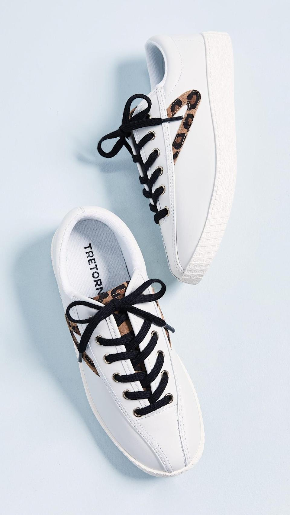 "<p>For a pop of leopard print, wear these <a href=""https://www.popsugar.com/buy/Tretorn-Nylite-25-Plus-Lace-Up-Sneakers-584513?p_name=Tretorn%20Nylite%2025%20Plus%20Lace%20Up%20Sneakers&retailer=shopbop.com&pid=584513&price=85&evar1=fab%3Aus&evar9=47571677&evar98=https%3A%2F%2Fwww.popsugar.com%2Ffashion%2Fphoto-gallery%2F47571677%2Fimage%2F47571942%2FTretorn-Nylite-25-Plus-Lace-Up-Sneakers&list1=shopping%2Cshoes%2Csneakers%2Csummer%2Csummer%20fashion%2Cfashion%20shopping&prop13=mobile&pdata=1"" rel=""nofollow noopener"" class=""link rapid-noclick-resp"" target=""_blank"" data-ylk=""slk:Tretorn Nylite 25 Plus Lace Up Sneakers"">Tretorn Nylite 25 Plus Lace Up Sneakers </a> ($85).</p>"