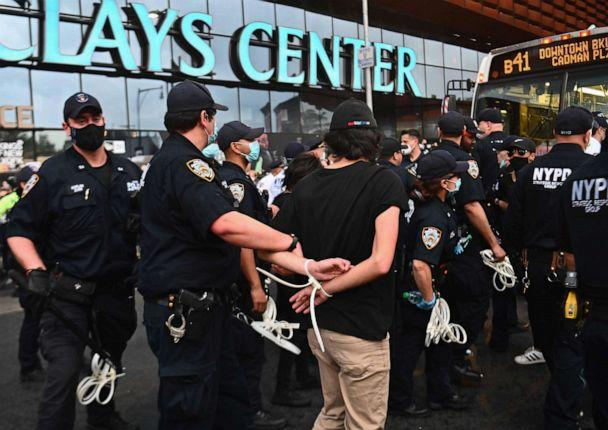 PHOTO: Police officers arrest a protester during a 'Black Lives Matter' protest near Barclays Center on May 29, 2020 in the Brooklyn borough of New York City, in outrage after George Floyd died while being arrested by a police officer in Minneapolis. (Angela Weiss/AFP via Getty Images)