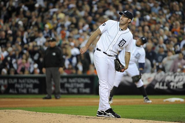 DETROIT, MI - OCTOBER 13: Justin Verlander #35 of the Detroit Tigers watches a two-run home run by Nelson Cruz #17 of the Texas Rangers in the eighth inning of Game Five of the American League Championship Series at Comerica Park on October 13, 2011 in Detroit, Michigan. (Photo by Harry How/Getty Images)