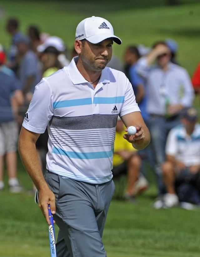 Sergio Garcia waves after making a par on the eighth hole, during the final round of the Bridgestone Invitational golf tournament, Sunday, Aug. 3, 2014, in Akron, Ohio. (AP Photo/Phil Long)