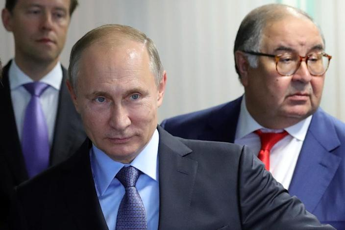 Kremlin-friendly billionaire Alisher Usmanov, seen here with Vladimir Putin, owns the Russian equivalent of Facebook (AFP Photo/Mikhail KLIMENTYEV)