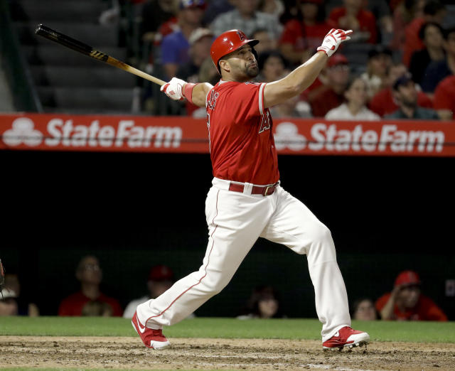 Los Angeles Angels' Albert Pujols watches his two-run home run against the San Francisco Giants during the sixth inning of a baseball game in Anaheim, Calif., Saturday, April 21, 2018. (AP Photo/Chris Carlson)